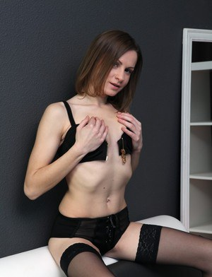 Tiny tits girl Xara loves masturbating in her sexy stockings