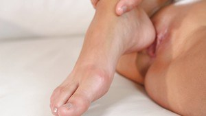 Foot fetish session features hot babe Melena Maria in pantyhose