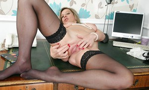 MILF is spreading her tight pussy in the office and showing body