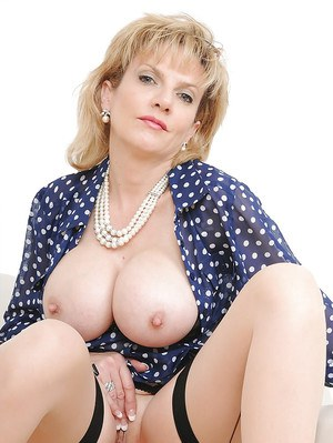 Blonde MILF with large tits Sonia showing her huge nipples