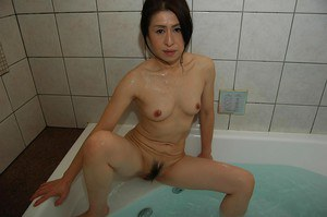 Sexy looking Asian Milf is ready to be washed and undressed