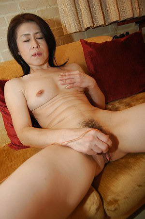 Beautiful brunette Asian masturbating with a nice sex toy
