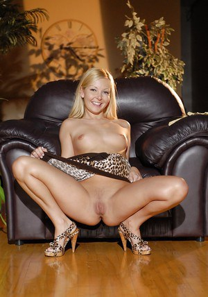 Nasty blonde babe with small tits Aaliyah undressing of the sofa
