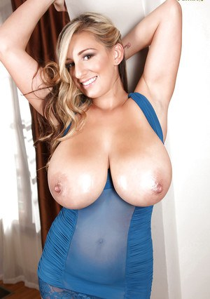 Stunning babe with big tits September Carrino shows her tattoos