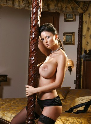 European milf Veronika Zemanova demonstrates her ass in stockings
