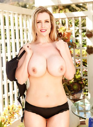 Clothed babe Brooke Britt reveals her big tits in a lingerie