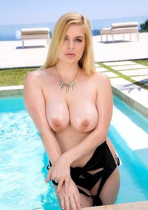 Outdoor posing of an sexy big tits blondie Danielle Delaunay at the pool