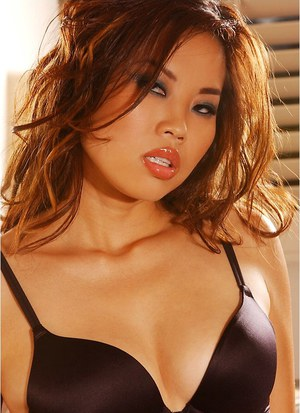 Undressing Asian babe Arielle Lee takes off her tight lingerie