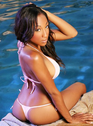 Outdoor posing at the pool features brunette ebony pornstar Alanna