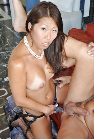 Femdom scene features an Asian pornstar with strapon Beti Hana