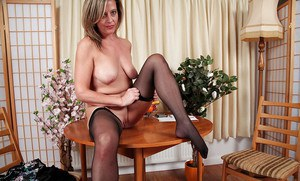 Mature slut with an amazing ass Silky Thighs Lou poses in stockings