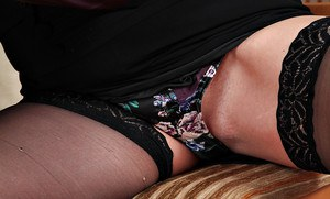 Mature saggy tits of Silky Thighs Lou revealed while she is in stockings