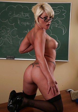 Milf teacher in sexy stockings and glasses Summer Storm poses