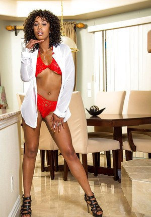 Ebony wife Misty Stone shows off her long legs and tiny tits