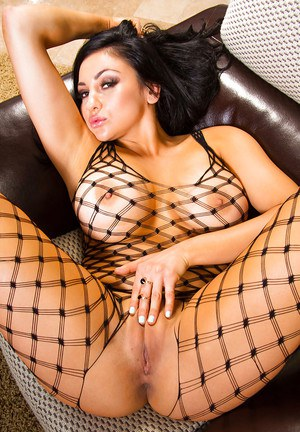 Big tits babe Audrey Bitoni dose some posing in her fishnet pantyhose