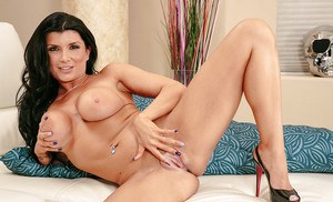 Brunette milf Romi Rain reveals her perfect ass and big tits