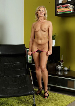 Blonde milf with tiny tits Carrie shows off her ass in high heels