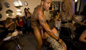 Interracial party with clothed ladies dancing with naked strippers