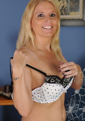 Mature blonde Sky Martin undresses her yellow skirt and lingerie