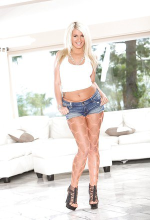 Blonde babe Layla Price shows off in tight shorts and high heels