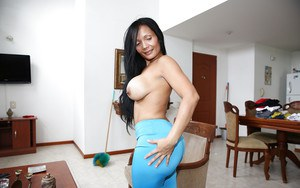 Sweet maid with brunette hair Casandra demonstrates her big tits