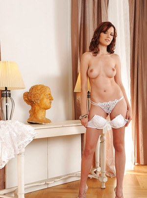 Redhead babe Kami shows off in her white lingerie and high heels