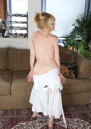 Undressing mature blonde Josie demonstrates her natural tiny tits