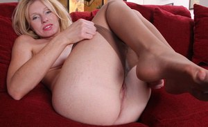 Undressing session with a hot milf babe Holly Jones in pantyhose