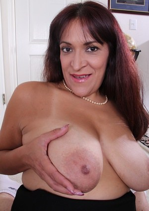 Mature fatty with brunette hair Veronica demonstrates her shaved pussy