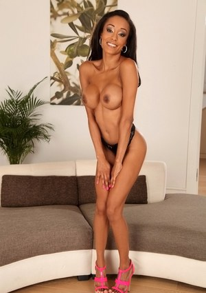 European Ebony babe Alyssa Divine masturbates in pink high heels