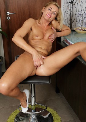 Masturbating mature blonde with tiny tits Carrie caught on camera