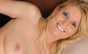 Undressing milf with blonde hair Sky Martin caught in close up