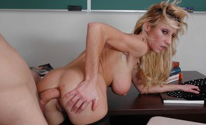 Milf teacher Regan Anthony is nailed hard in the office by her student