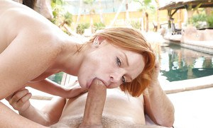 Outdoor blowjob done by a hot redhead Alex Tanner to a big cock