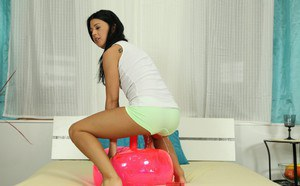 Pissing teen babe Lolipop shows off her huge pink toy in close up