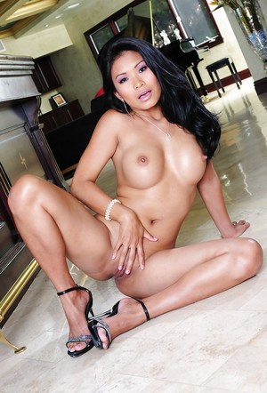 Asian babe with brunette hair John Leslie shows off in high heels