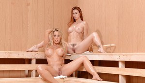 Hot lesbians Capri Cavanni and Karlie Montana show their wet pussies