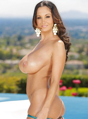 European milf babe with brunette hair Ava Addams poses outdoor