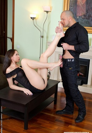European brunette Aruna Aghora dose footjob in a foot fetish scene