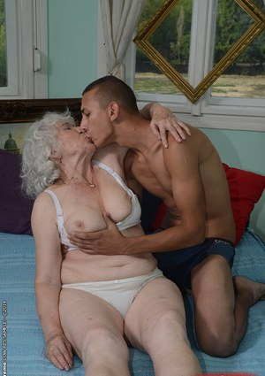 Hairy pussy of sweet granny Norma gets nailed hardcore with a young cock