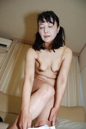 Tiny tits Asian mature Kiyoe Majima in a close up undressing scene
