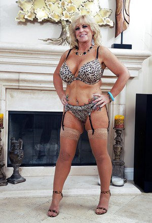 Blonde mature Zena Rey shows off in high heels and lingerie