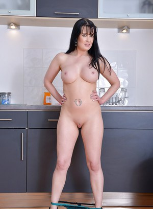 European brunette Tanya Cox demonstrates her mature ass and big tits