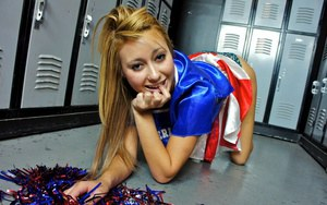 Latina schoolgirl Marina Angel poses in her sexy cheerleader suit