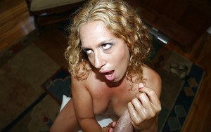 Fantastic handjob done by a stunning gonzo milf, who also receives cumshot