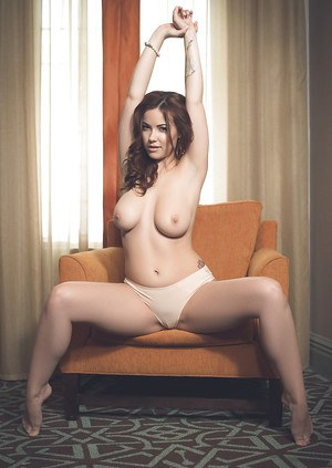 Centerfold babe with big tits and sexy ass Elizabeth Marxs poses