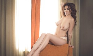 Centerfold brunette babe Elizabeth Marxs shows off her legs