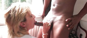 Mature cutie Lady Sonia enjoys Interracial fuck in her stockings