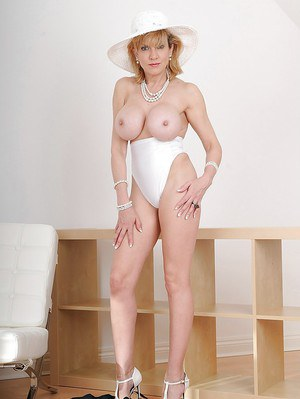 Mature cutie Lady Sonia reveals her big tits in sexy high heels
