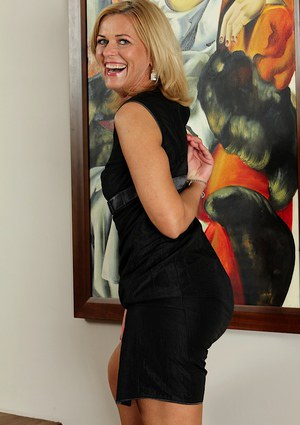 Undressing scene features blonde milf babe Carrie in high heels